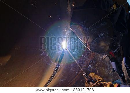 Welding Works On Metal  Heat Exchanger Using Manual Arc Welding