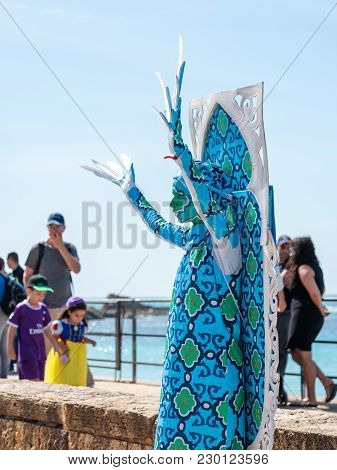 Caesarea, Israel, March 03, 2018 : A Festival Participant Dedicated To Purim Stands Dressed In A Fai