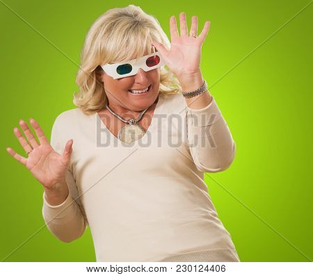 Terrified Woman Watching 3d Movie against a green background
