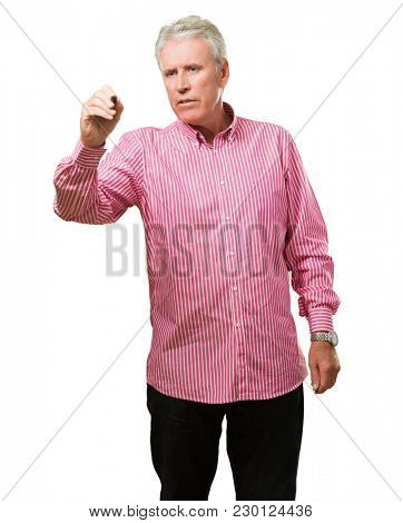 Mature man holding a pen against a white background