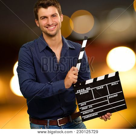 Happy Young Man Holding Clapboard, Outdoor