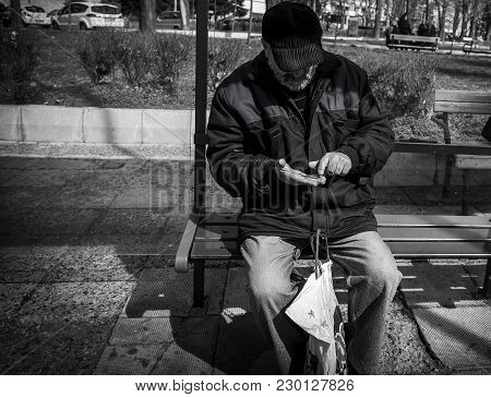 A Man Sits Down And Counts His Last Money. A Poor And Unemployed Man.editorial Use Only.burgas/bulga