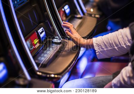 Casino Video Slots Game Playing. Caucasian Woman Feeling Lucky In The Vegas Casino.