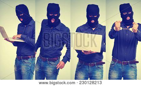 burglar hacker using a computer with balaclava