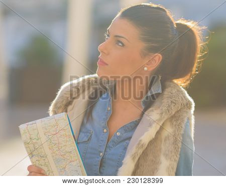 Beautiful Woman Holding Map, Outdoors