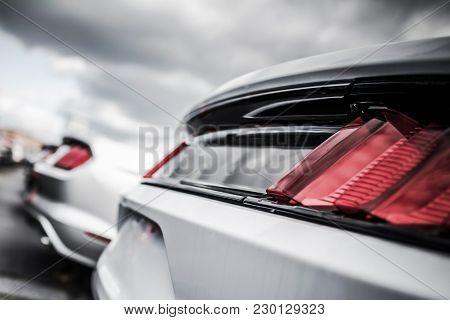 Certified Pre Owned Vehicles In Stock. Car Dealer Lot. Vehicle Rear Closeup.