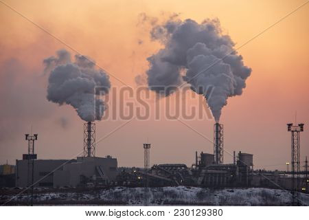 Chimney smoking stack. Air pollution and climate change theme. Poor environment in the city. Environ