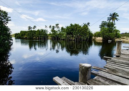 Beautiful Nature Of Terengganu, Malaysia At Sunny Day, River And Reflection With Blue Sky Background