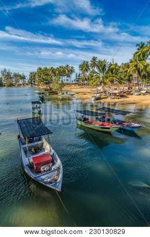 Image Of Fisherman Boat Under Blue Sky And Clouds