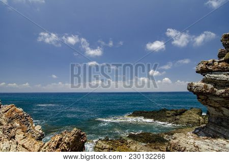 Blurred Image Background, Beauty Nature Of Kapas Island Located In Terengganu, Malaysia. Rocky Shore