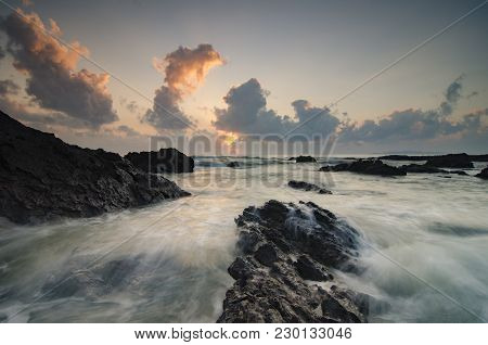 Beautiful Waves Splashing On Unique Rocks Formation At Pandak Beach Located In Terengganu,malaysia O