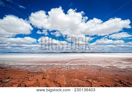 South Australia Outback desert with dry Salt Lake Eyre under cloudy sky as panorama