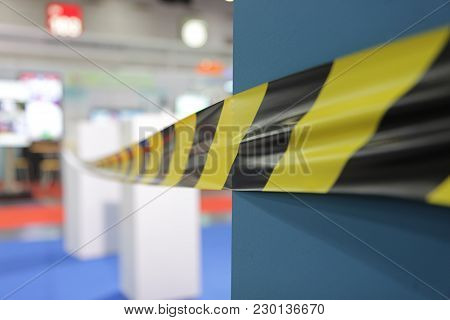 Barrier Tape For No Entry At An Exhibition.do Not Cross Ribbons.;yellow And Black Danger Tapes;