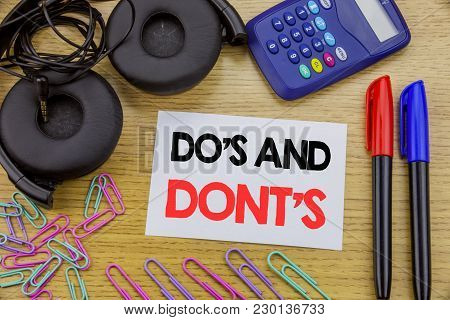 Writing Text Showing Do S And Do Not Donts. Business Concept For Guide Allowed Written On Sticky Not