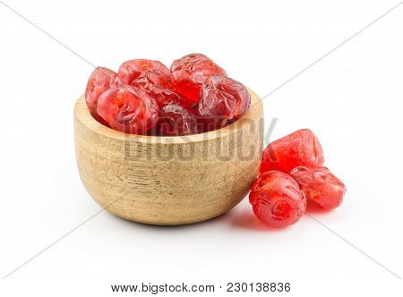 Red Dry Cherries In A Wooden Bowl Isolated On White Background