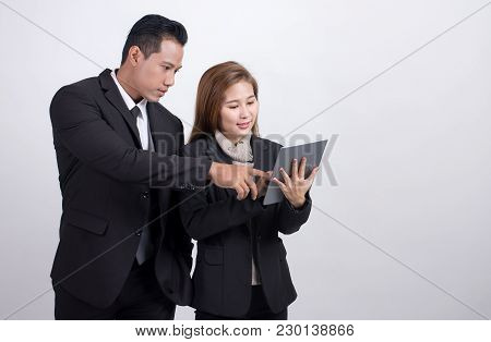 Portrait Of Asians Executive Businessman And Adviser Businesswoman Discussing And Working Together W