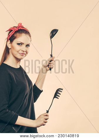 Joy And Fun During Food Preparation. Blonde Smiling Woman In Retro Style Having Fun In Kitchen. Play