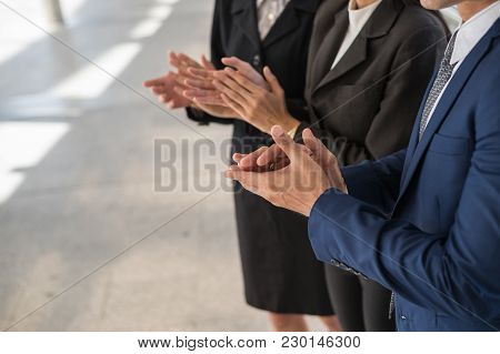 Business Man And Business Woman Clap Their Hands To Congratulate The Signing Of An Agreement Or Cont