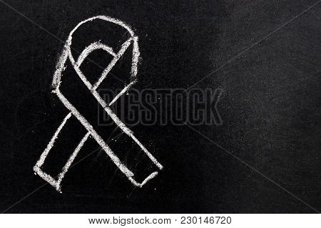 White Chalk Drawing As Black Ribbon Shape On Black Board Background (concept For Symbol Of Remembran
