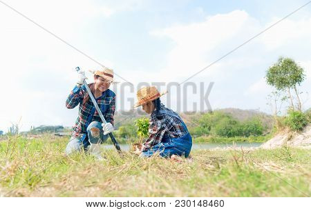 Asian Family Mom And Child Girl Plant Sapling Tree In The Nature Spring For Reduce Global Warming Gr