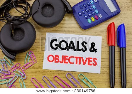 Writing Text Showing Goals Objectives. Business Concept For Plan Success Vision Written On Sticky No