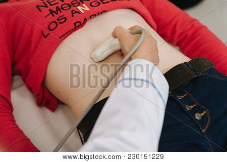 Gynecologist Checking Fetal Life With Scanner. Ultrasound Test In Pregnancy And Medical Care Concept