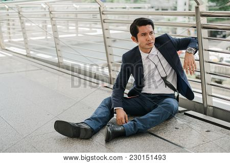 Businessman Unemployed From Company Sitting On Street, He Is Feeling Of Stressed And Sadness, Concep