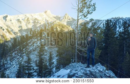 Beautiful View Of The Mountain Peaks Of The Baikal Mountains In The Snow At Sunrise. Concept Of Trav
