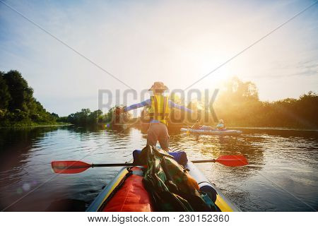 Happy Boy Kayaking On The River. Active Boy Having Fun Enjoying Adventurous Experience With Kayak On