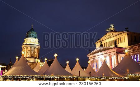 German Church, Concert Hall And Gendarmenmarkt Christmas Market In Gendarmenmarkt Square, Berlin Cit