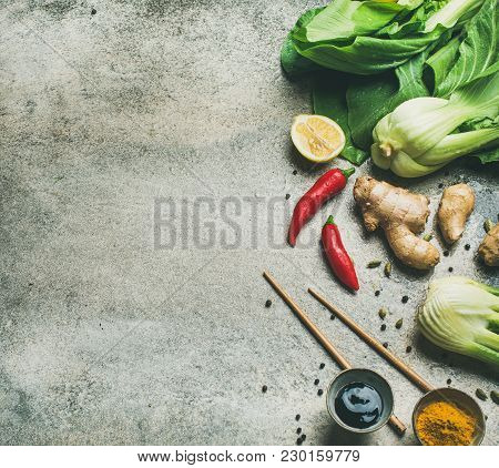 Asian Cuisine Ingredients Over Grey Background, Top View, Copy Space. Flat-lay Of Vegetables, Spices