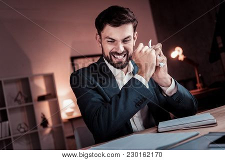 Wrong Idea. Unhappy Angry Busy Man Sitting In The Cabinet Looking Down And Tearing The Document.