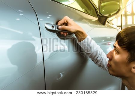 Asian Man Opens Car Door With Smart Keyless For Automotive Or Transportation Image