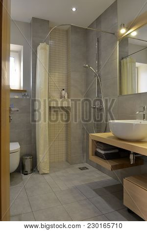 Grey Stone Pattern Tiled Contemporary Bathroom Interior Design With Minimal Natural Wood Furniture D