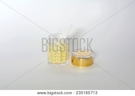 Bottle Of Pearly Consistency Luxurious Face Cream Opened Golden Lid