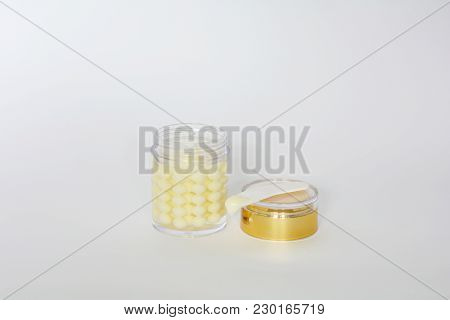 White Isolated Bottle Of Pearly Consistency Luxurious Face Cream Opened Golden Lid