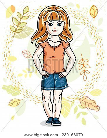 Cute Happy Little Red-haired Girl Posing On Background Of Autumn Landscape And Wearing Fashionable C