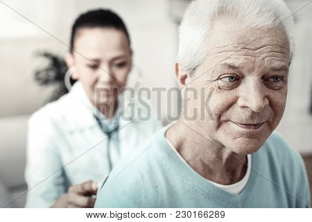 Everything Will Be Ok. Aged Gray Haired Pleasant Man Sitting In The Room Waiting For The Doctors Dec