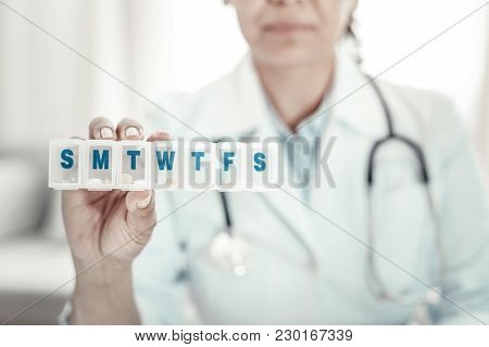 Prescription Medicine. Serious Responsible Reliable Nurse Showing Pills And Holding In Right Hand An