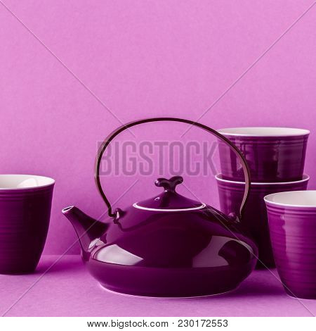 Purple Teapot And Cups On A Lilac Background