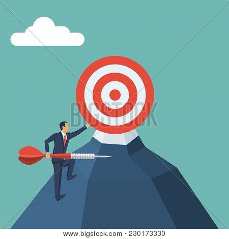 Businessman Climbs Uphill With An Arrow In Hand To Reach The Goal. Aim In Business Concept. Target A