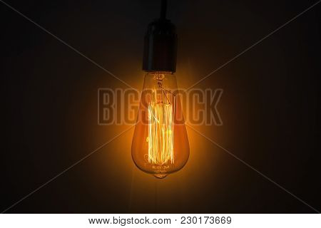 Old Vintage Edison Bulb In The Dark