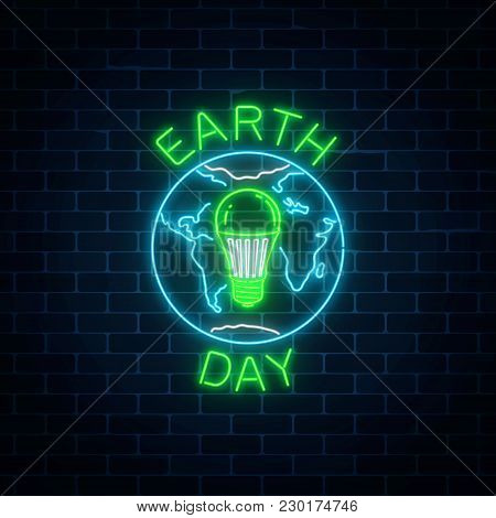 Glowing Neon Sign Of World Earth Day With Globe Symbol And Green Led Light Bulb Inside On Dark Brick
