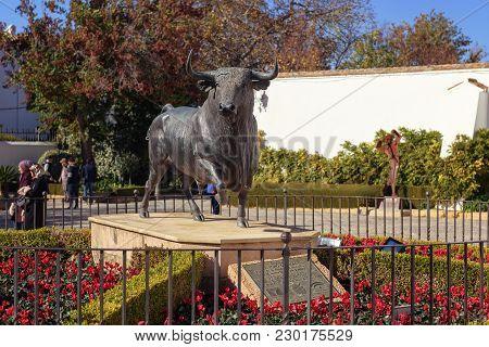 Ronda, Spain - December 2017: Black Bull Statue Outside Ronda Bull Fighting Arena.