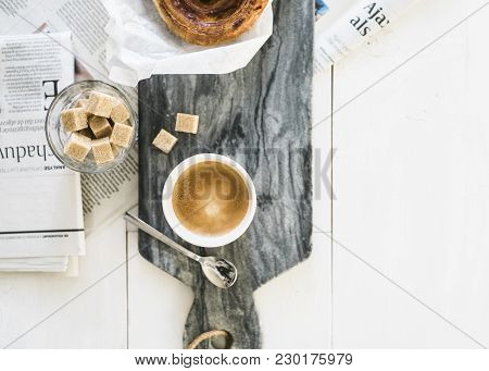 Breakfast Minimalist / Scandinavian Style. White Wooden Floor, Sugar , Coffee And A Danish Breadroll