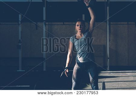 Young Woman Doing Exercises With Dumbbell At Box On A Fitness Session