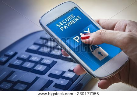 Female Hands Using A Smartphone And Paying Online.secure Payment Concept.