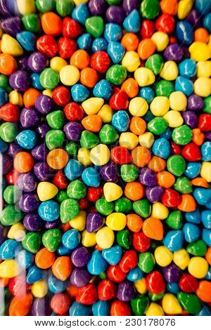 These Are Candy Coated Chocolate Chips In A Pile.