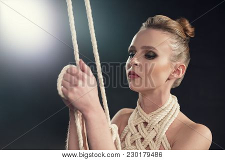Beautiful Naked Woman Tied Up With Rope Portrait Against Black Wall