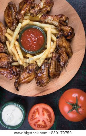Grilled or oven roasted chicken wings glazed with barbecue sauce